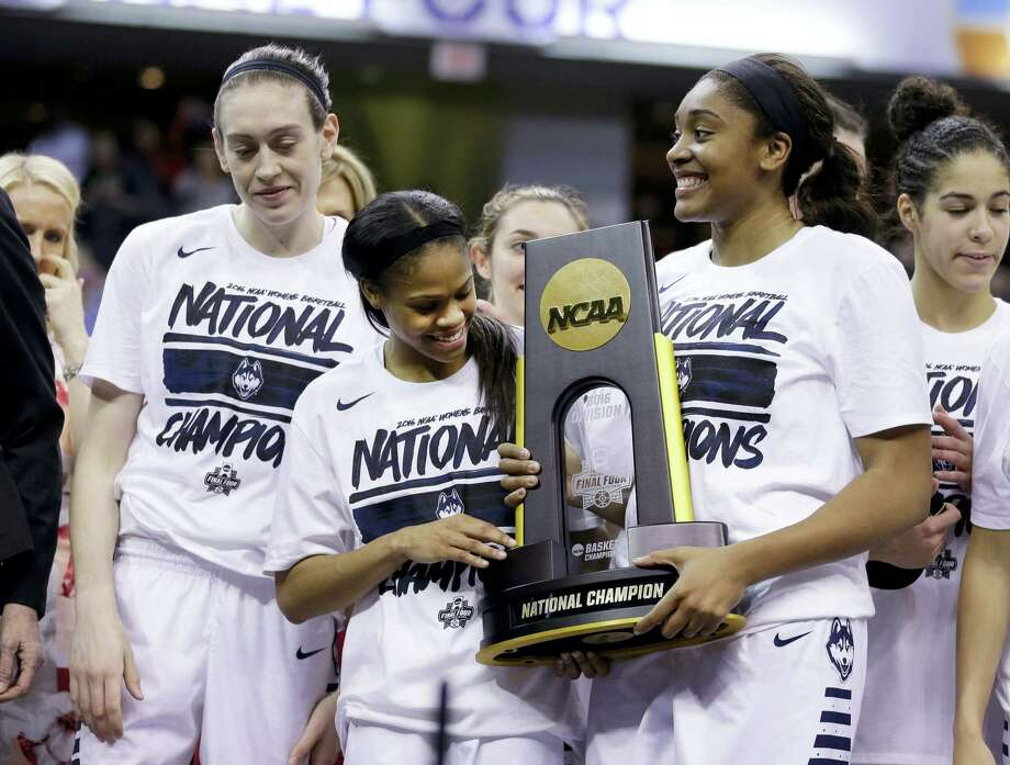 UConn's Breanna Stewart, left, Moriah Jefferson, center, and Morgan Tuck celebrate with the national championship trophy after defeating Syracuse on Tuesday in Indianapolis. Photo: Michael Conroy — The Associated Press  / AP