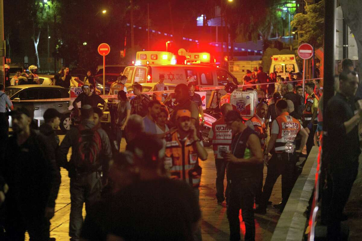 Ambulances are seen at the scene of a shooting attack in Tel Aviv, Israel, Wednesday, June 8, 2016. Two Palestinian gunmen opened fire in central Tel Aviv Wednesday night, killing three people and wounding at least five others, Israel police said.