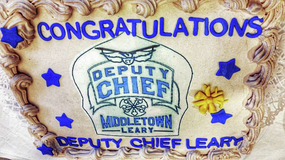 Leary's celebratory cake is emblazoned with a chief's badge.