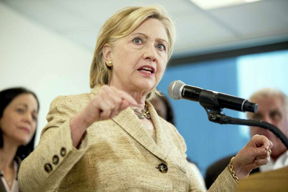 Democratic presidential candidate Hillary Clinton speaks to medical professionals after taking a tour of Borinquen Health Care Center in Miami, Fla., Tuesday. Photo: Andrew Harnik — The Associated Press  / Copyright 2016 The Associated Press. All rights reserved. This material may not be published, broadcast, rewritten or redistribu