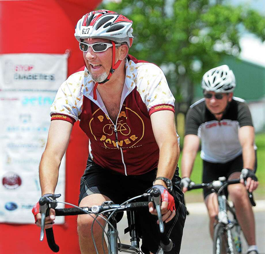 Michael Beck, of the Pedal Power team, completes a 50-kilometer ride at the American Diabetes Association's Tour de Cure in 2013. Photo: File Photo  / TheMiddletownPress