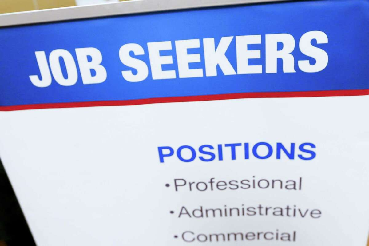This March 30, 2016 photo shows a sign designed to attract employment seekers that lines a booth for job recruiters at a Job Fair in Pittsburgh. On April 5, 2016, the Labor Department reports on job openings and labor turnover for February.