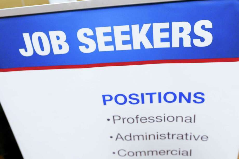 This March 30, 2016 photo shows a sign designed to attract employment seekers that lines a booth for job recruiters at a Job Fair in Pittsburgh. On April 5, 2016, the Labor Department reports on job openings and labor turnover for February. Photo: AP Photo/Keith Srakocic  / Copyright 2016 The Associated Press. All rights reserved. This material may not be published, broadcast, rewritten or redistributed without permission.
