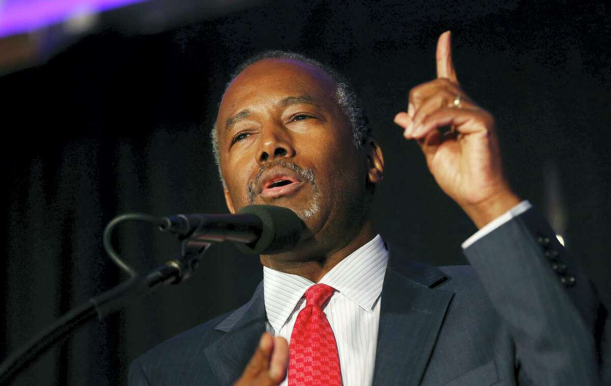 In this Aug. 25, 2016 photo, former Republican presidential candidate Dr. Ben Carson speaks before Republican presidential candidate Donald Trump's arrival at a campaign rally in Manchester, N.H. President-elect Donald Trump chose Carson to become secretary of the Department of Housing and Urban Development.