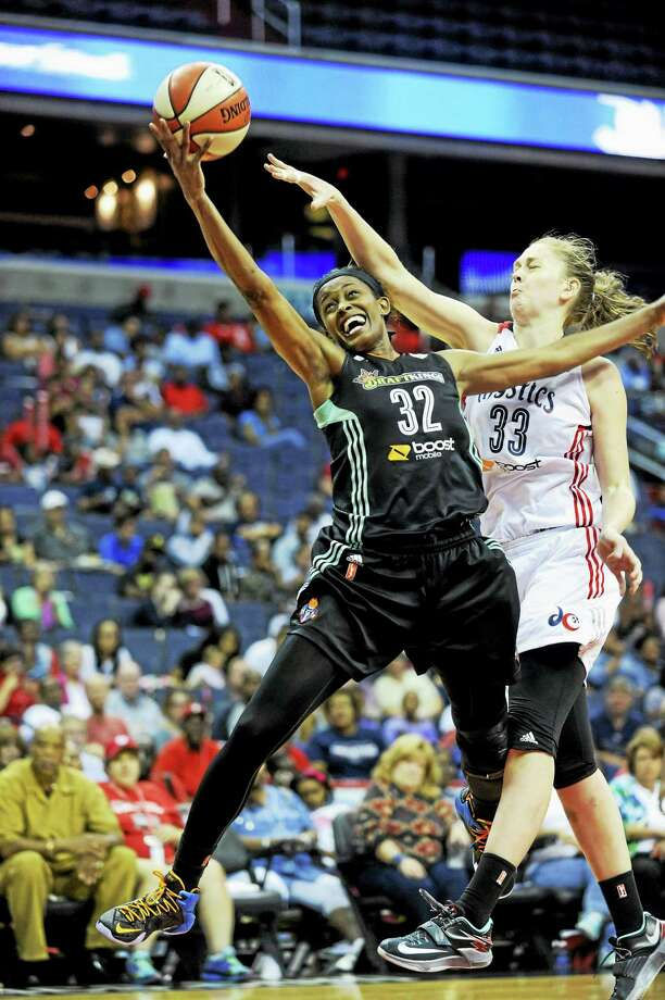 Swin Cash (32) announced on Tuesday that she will retire from the WNBA at the end of the season. Photo: Kevin Wolf — The Associated Press  / FR33460 AP