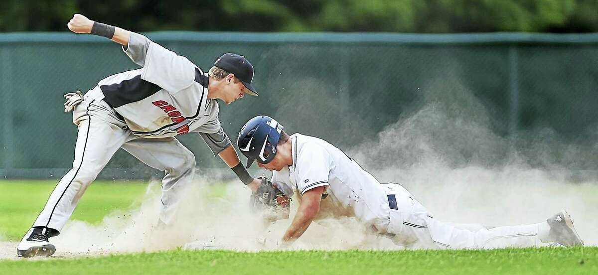 Cromwell's Amir Nitowski is late with the tag as Morgan's Liam Neri slides in safe at second in Tuesday's Class S semfinal game at Beehive Stadium in New Britain. Morgan won 6-0 and will take on No. 4 St. Paul for the Class S championship at Palmer Field in Middletown.