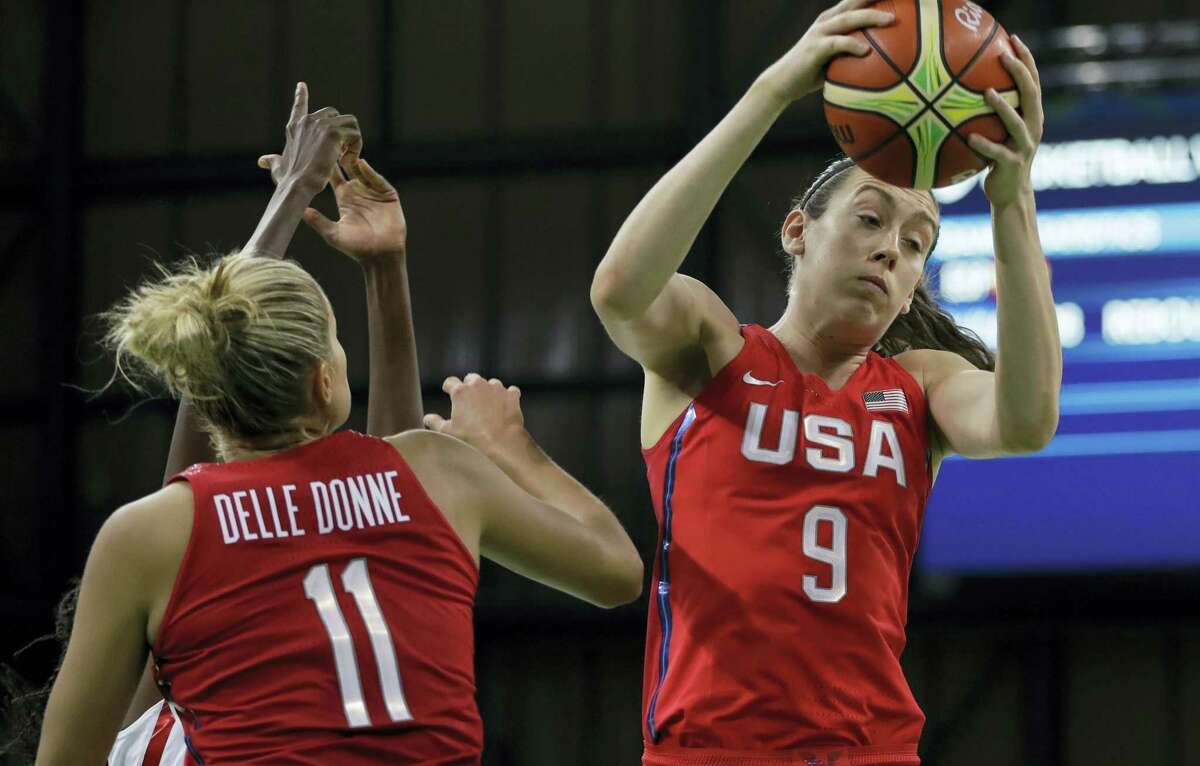 United States forward Breanna Stewart (9) grabs a rebound during the second half of Monday's win over Spain.