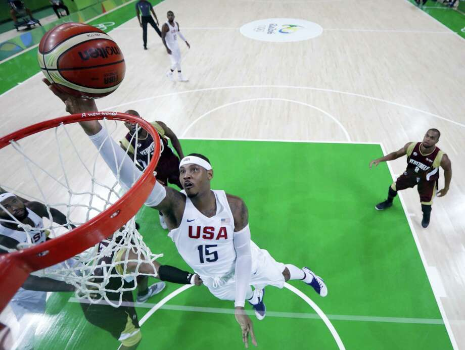 United States' Carmelo Anthony (15) scores against Venezuela during Monday's game in Rio de Janeiro, Brazil. Photo: Eric Gay — The Associated Press  / Copyright 2016 The Associated Press. All rights reserved. This material may not be published, broadcast, rewritten or redistribu