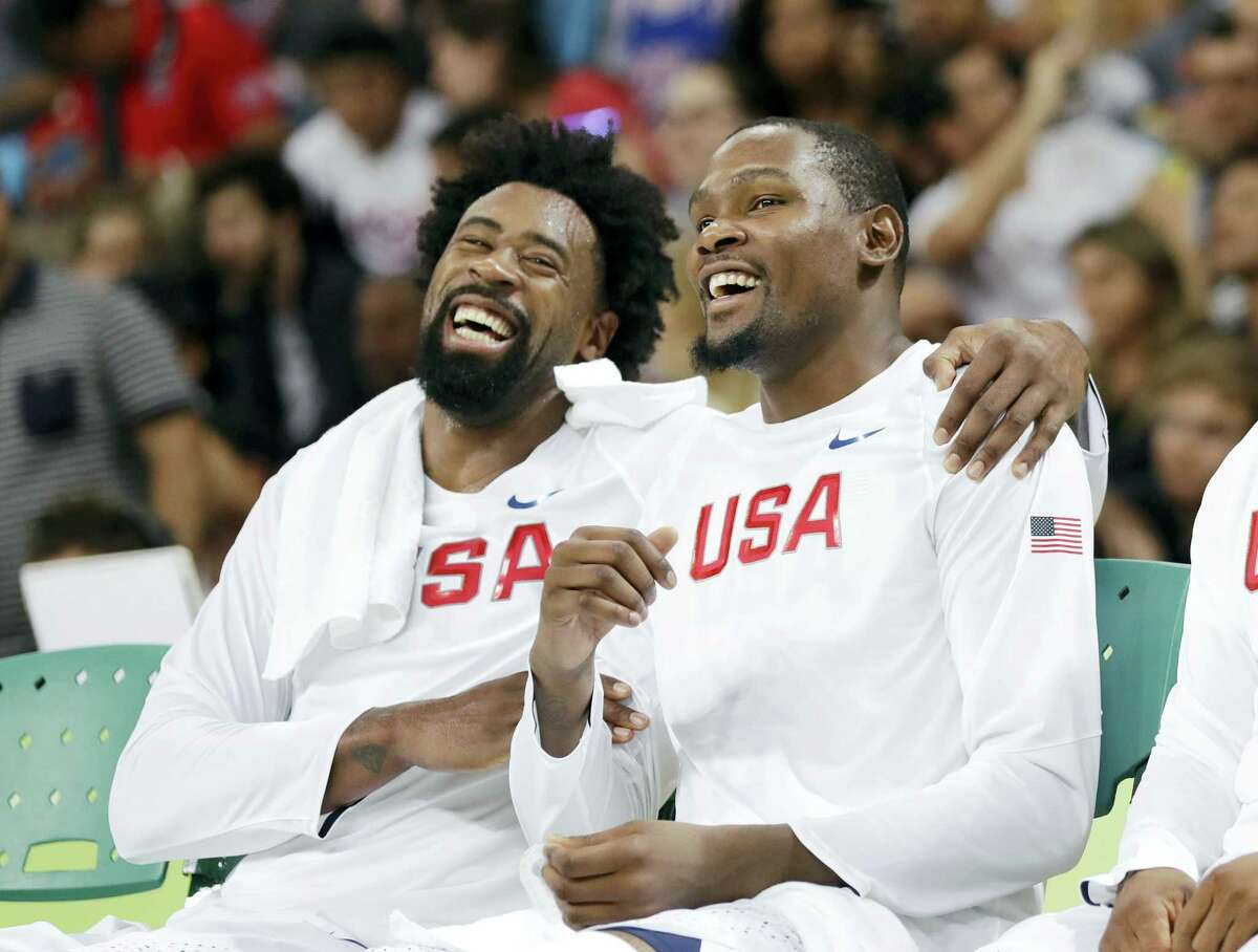 DeAndre Jordan, left, jokes with teammate Kevin Durant.