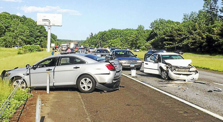 A state trooper was seriously hurt Monday evening after a car crashed into his cruiser while he helping a disabled motorist off of Interstate 691 in Cheshire. Police reminded motorists to move over if they see emergency vehicles with their lights flashing. Photo: Photo From The Connecticut State Police
