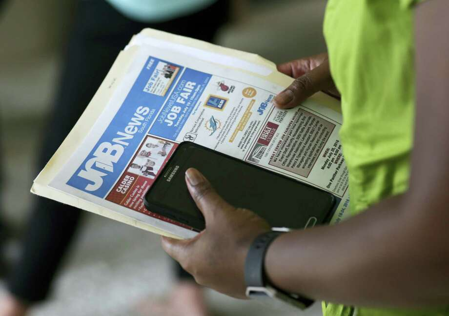 In this July 19, 2016 photo, a job applicant attends a job fair in Miami Lakes, Fla. On Oct. 13, 2016 the Labor Department reports on the number of people who applied for unemployment benefits a week earlier. Photo: AP Photo/Lynne Sladky, File  / Copyright 2016 The Associated Press. All rights reserved. This material may not be published, broadcast, rewritten or redistribu