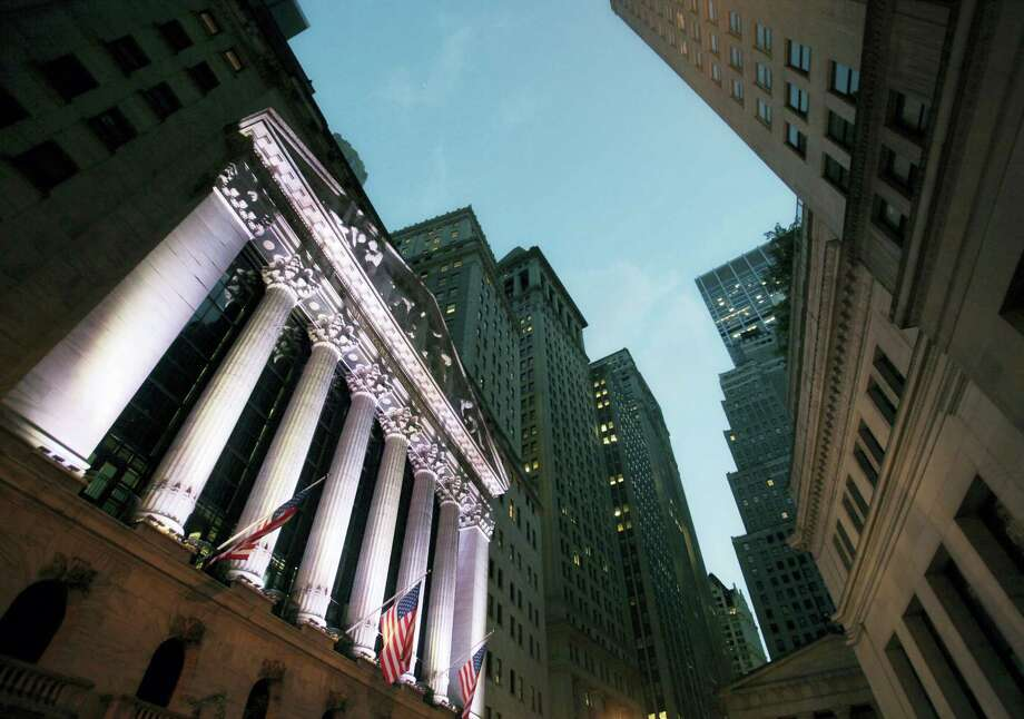 FILE - In this Wednesday, Oct. 8, 2014, file photo, American flags fly in front of the New York Stock Exchange. U.S. stocks are falling early Thursday, Oct. 13, 2016, and following global markets lower after a steep drop in China'Äôs exports, a troubling sign for the second-largest economy in the world. Banks and mining companies are taking some of the largest losses. Photo: Mark Lennihan — The Associated Press File / Copyright 2016 The Associated Press. All rights reserved. This material may not be published, broadcast, rewritten or redistribu