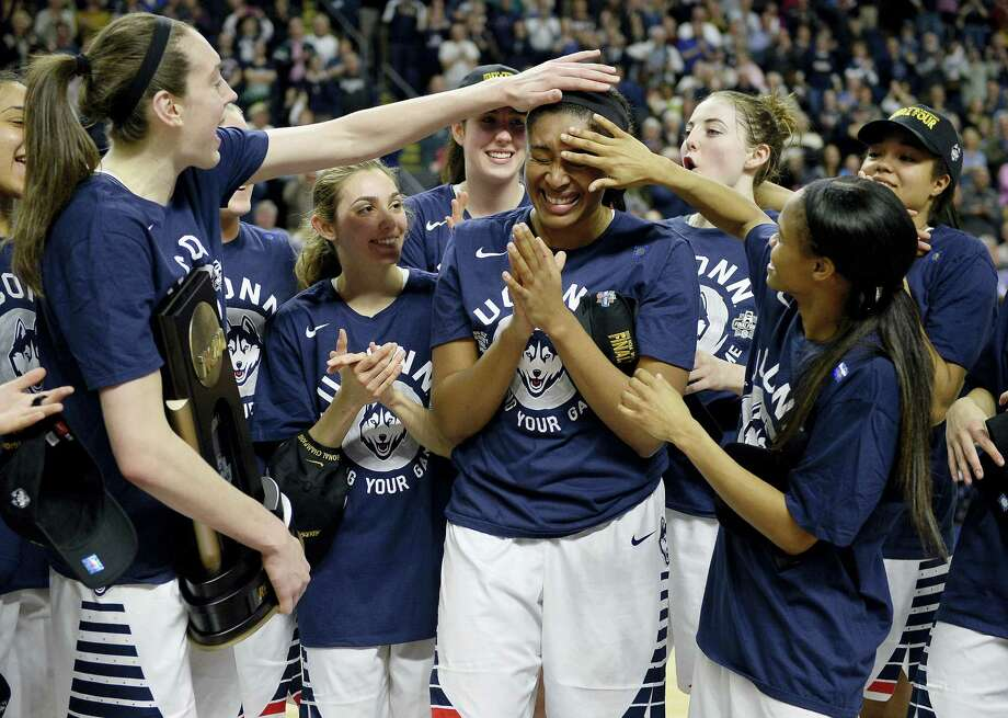 Connecticut's Breanna Stewart, left, and Moriah Jefferson, right, celebrate with Morgan Tuck, center, after winning 86-65 over Texas in a college basketball game in the regional final of the women's NCAA Tournament, Monday, March 28, 2016, in Bridgeport, Conn. (AP Photo/Jessica Hill) Photo: AP / FR125654 AP
