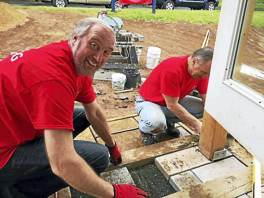 """As a kick-off project for """"Liberty Lends a Hand,"""" 27 employees from across Liberty Bank volunteered their time over the course of three days at a Middlesex County Habitat for Humanity house at 202 Summer St. in Portland. Photo: Contributed Photo"""