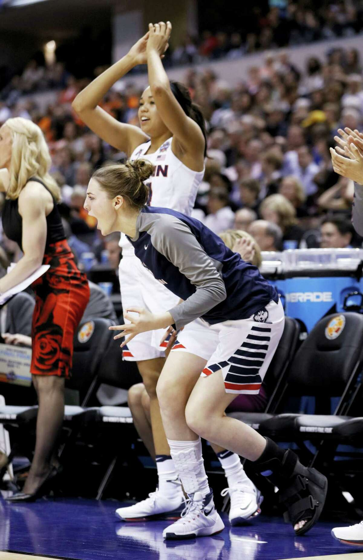 UConn's Katie Lou Samuelson cheers during the second half of Sunday night's national semifinal game against Oregon State. Samuelson suffered a season-ending broken foot.