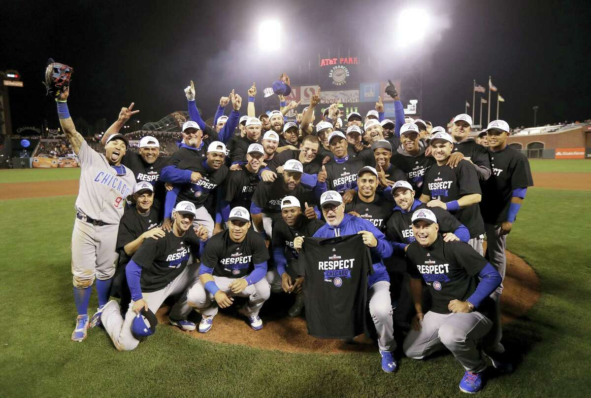 Chicago Cubs players and coaches celebrate after Game 4 of baseball's National League Division Series in San Francisco.