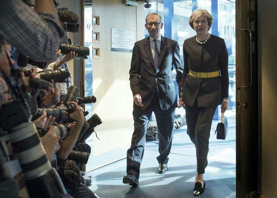 Britain's Prime Minister Theresa May and her husband Philip are watched by the media as they arrive at the Conservative Party Conference in Birmingham, England, Oct. 2. Photo: Stefan Rousseau — PA Via AP   / PA