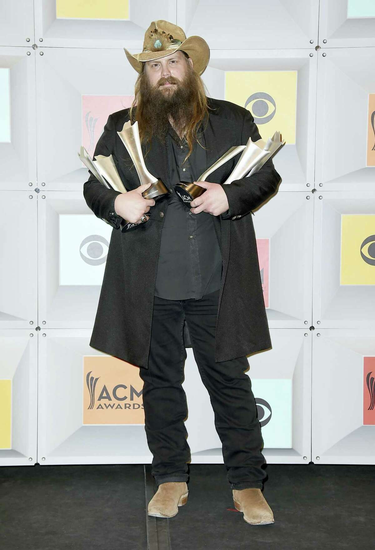 """Chris Stapleton poses in the press room with the awards for album of the year for """"Traveller"""", new male vocalist of the year, male vocalist of the year and song of the year for """"Nobody to Blame"""", at the 51st annual Academy of Country Music Awards at the MGM Grand Garden Arena on Sunday, April 3, 2016, in Las Vegas. (Photo by Jordan Strauss/Invision/AP)"""