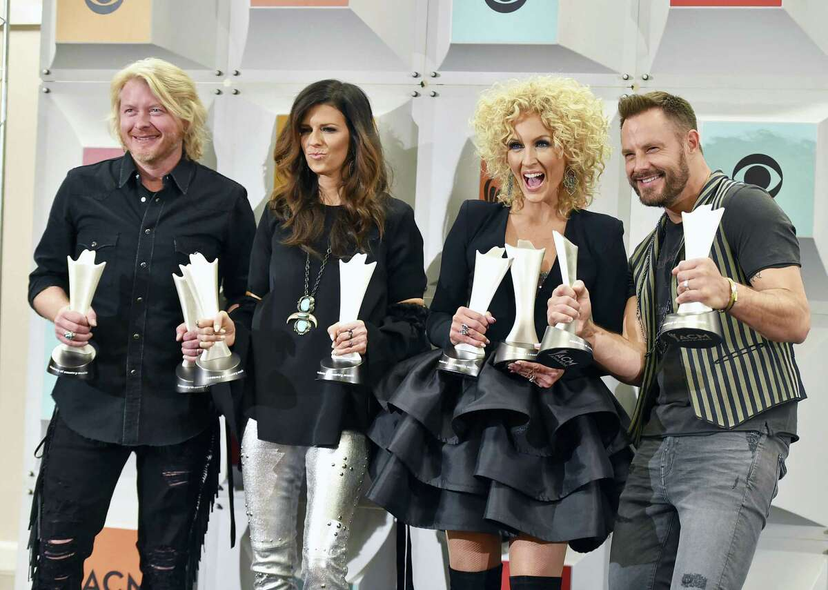 Little Big Town, winner of the award for vocal group of the year, and vocal event of the year for Smoking' And Drinkin', pose in the press room at the 51st annual Academy of Country Music Awards at the MGM Grand Garden Arena on Sunday, April 3, 2016, in Las Vegas. Pictured from left are Phillip Sweet, Karen Fairchild, Kimberly Schlapman and Jimi Westbrook. (Photo by Jordan Strauss/Invision/AP)