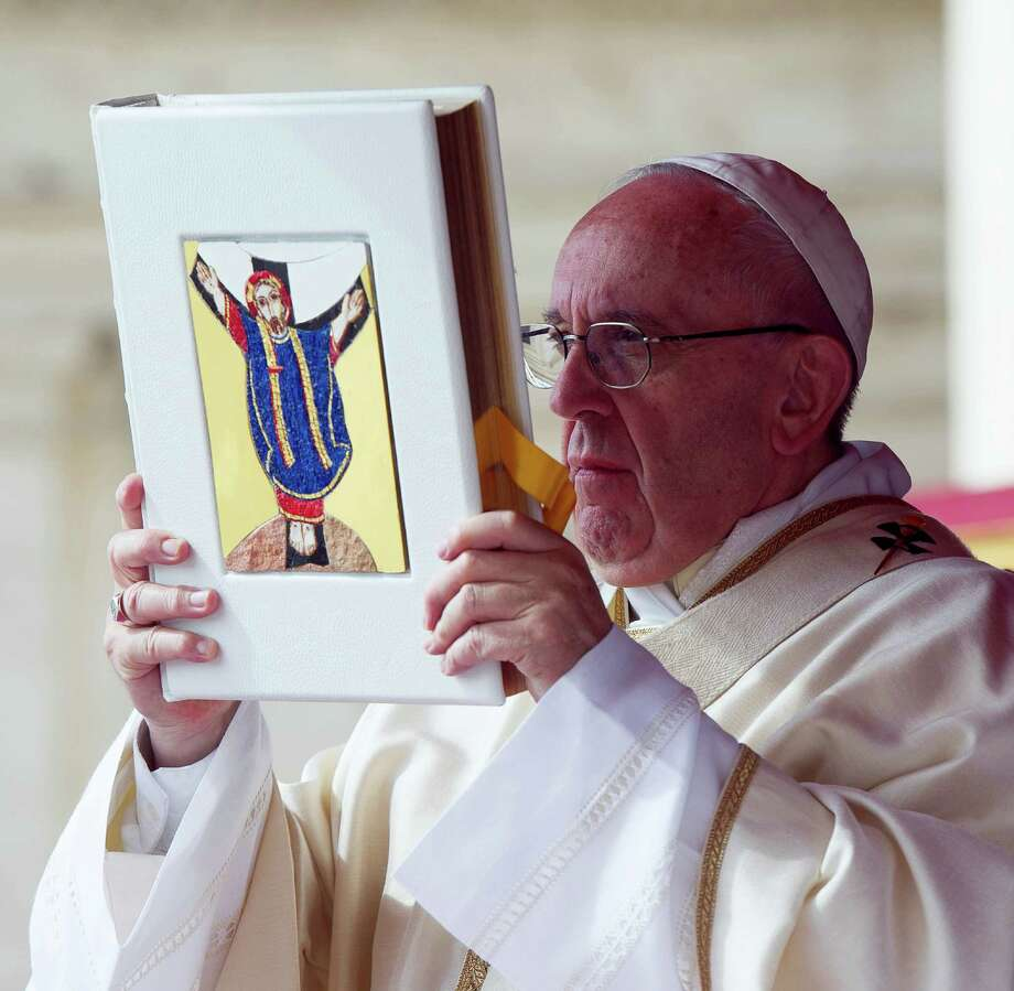 Pope Francis celebrates a Jubilee Mass for priests in St. Peter's Square at the Vatican Friday. Photo: L'Osservatore Romano — Pool Photo Via AP  / Copyright 2016 The Associated Press. All rights reserved. This material may not be published, broadcast, rewritten or redistribu