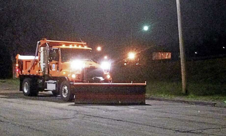 A plow crew from the Connecticut Department of Transportation was standing ready early Monday near the Interstate 95 northbound Exit 43 on ramp in West Haven. A coating to 2 inches of snow was expected there and elsewhere in Greater New Haven. Photo: Wes Duplantier — The New Haven Register