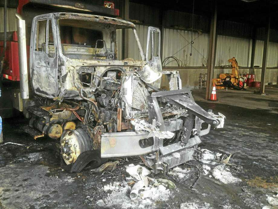The East Hampton town dump truck that caught fire Monday was a total loss. Photo: Jeff Mill — The Middletown Press