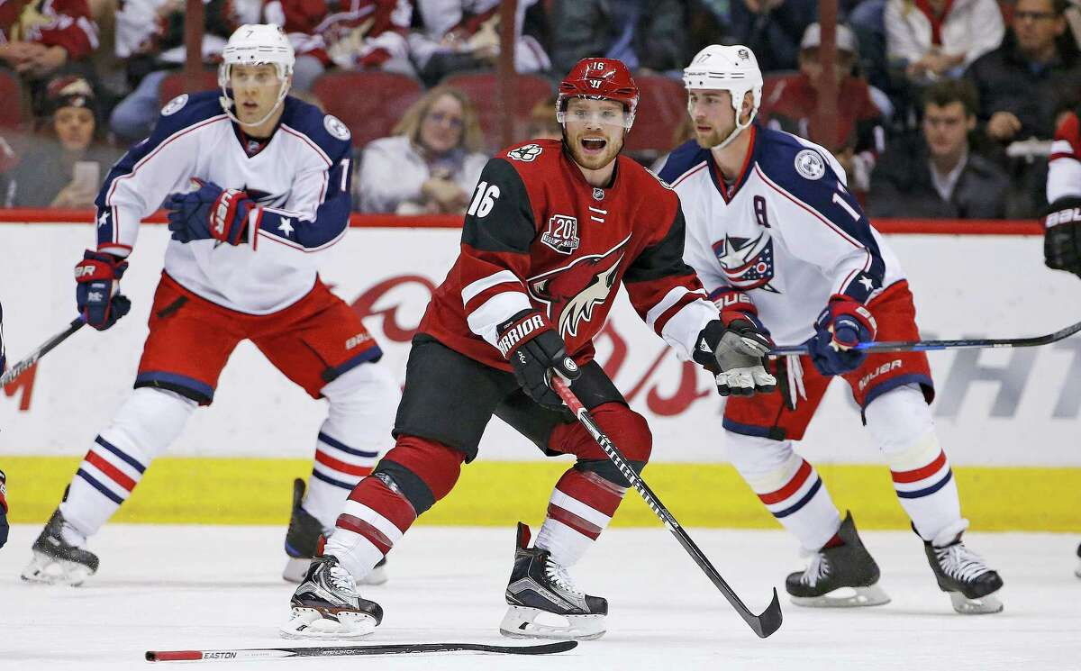 Arizona Coyotes left wing Max Domi (16) pleads his case after being whistled for a penalty against the Columbus Blue Jackets during the first period of an NHL hockey game Saturday, Dec. 3, 2016, in Glendale, Ariz. The Blue Jackets defeated the Coyotes 3-2 in a shootout.