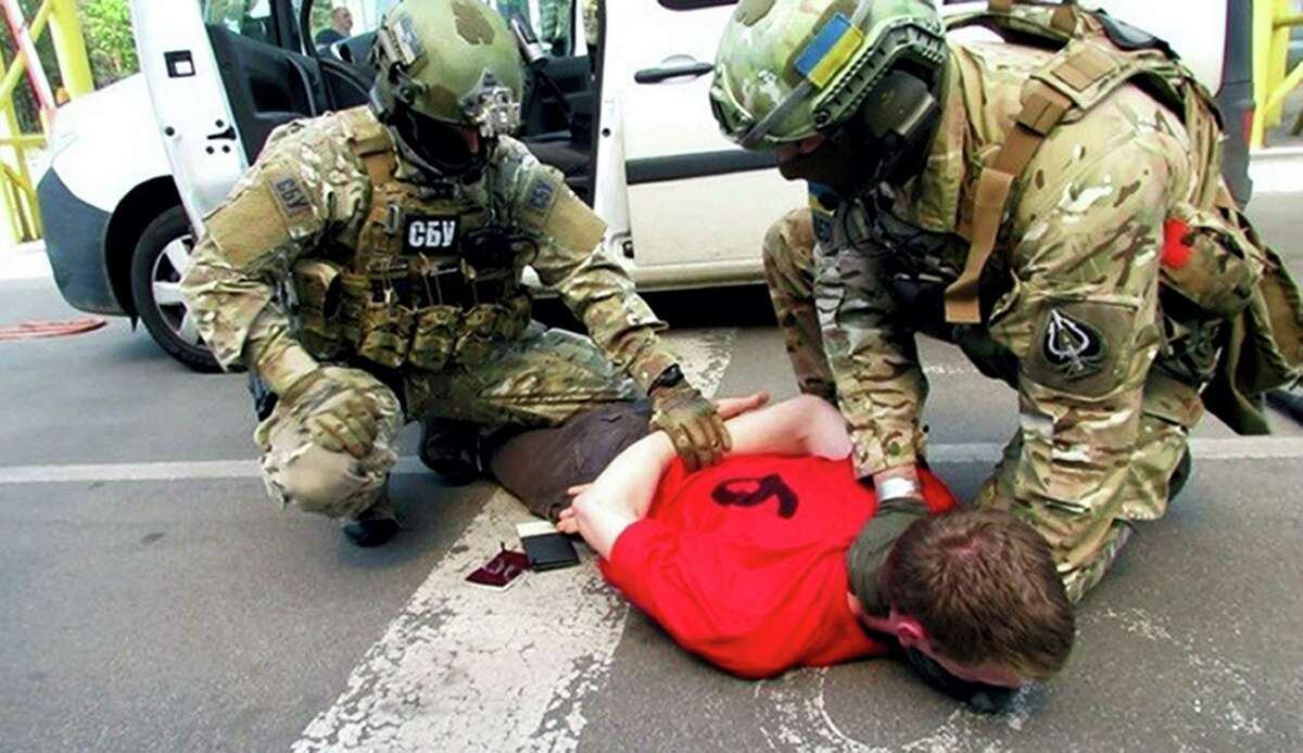 In this image, provided by the Ukrainian Intelligence Agency SBU on Monday, June 6, 2016, SBU agents detain a suspect at the Yahodyn border crossing on the Ukrainian-Polish border, Ukraine. Ukraine's intelligence agency SBU said on Monday it has thwarted a plot to attack soccer's European Championships in France by arresting a Frenchman who wanted to cross from Ukraine into the European Union armed to the teeth.