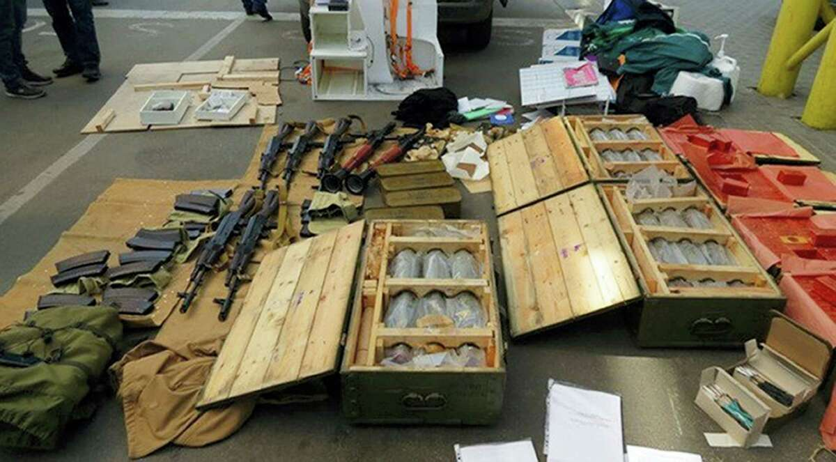 In this image, provided by the Ukrainian Intelligence Agency SBU on Monday, June 6, 2016, confiscated ammunition and explosives are on a display at the Yahodyn border crossing on the Ukrainian-Polish border, Ukraine. Ukraine's intelligence agency SBU said on Monday it has thwarted a plot to attack soccer's European Championships in France by arresting a Frenchman who wanted to cross from Ukraine into the European Union armed to the teeth.