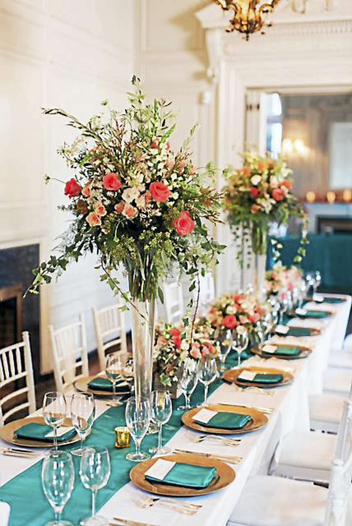 Flowers by Flowers by Danielle, use different types of vessels to create visual interest (photo by Vicki + Erik Photography)