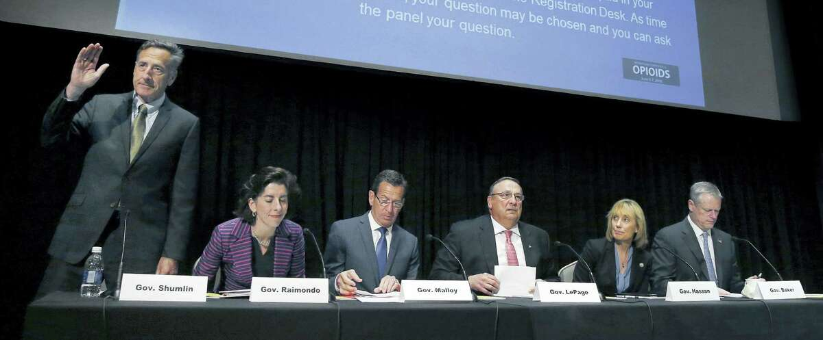 Vermont Gov. Peter Shumlin, left, stands alongside his New England counterparts during an opioid abuse conference Tuesday, June 7, 2016, in Boston. Seated from left are Rhode Island Gov. Gina Raimondo, Connecticut Gov. Dannel P. Malloy, Maine Gov. Paul LePage, New Hampshire Gov. Maggie Hassan and Massachusetts Gov. Charlie Baker. The governors met to discuss strategies to deal with the opioid addiction problem in all their states.