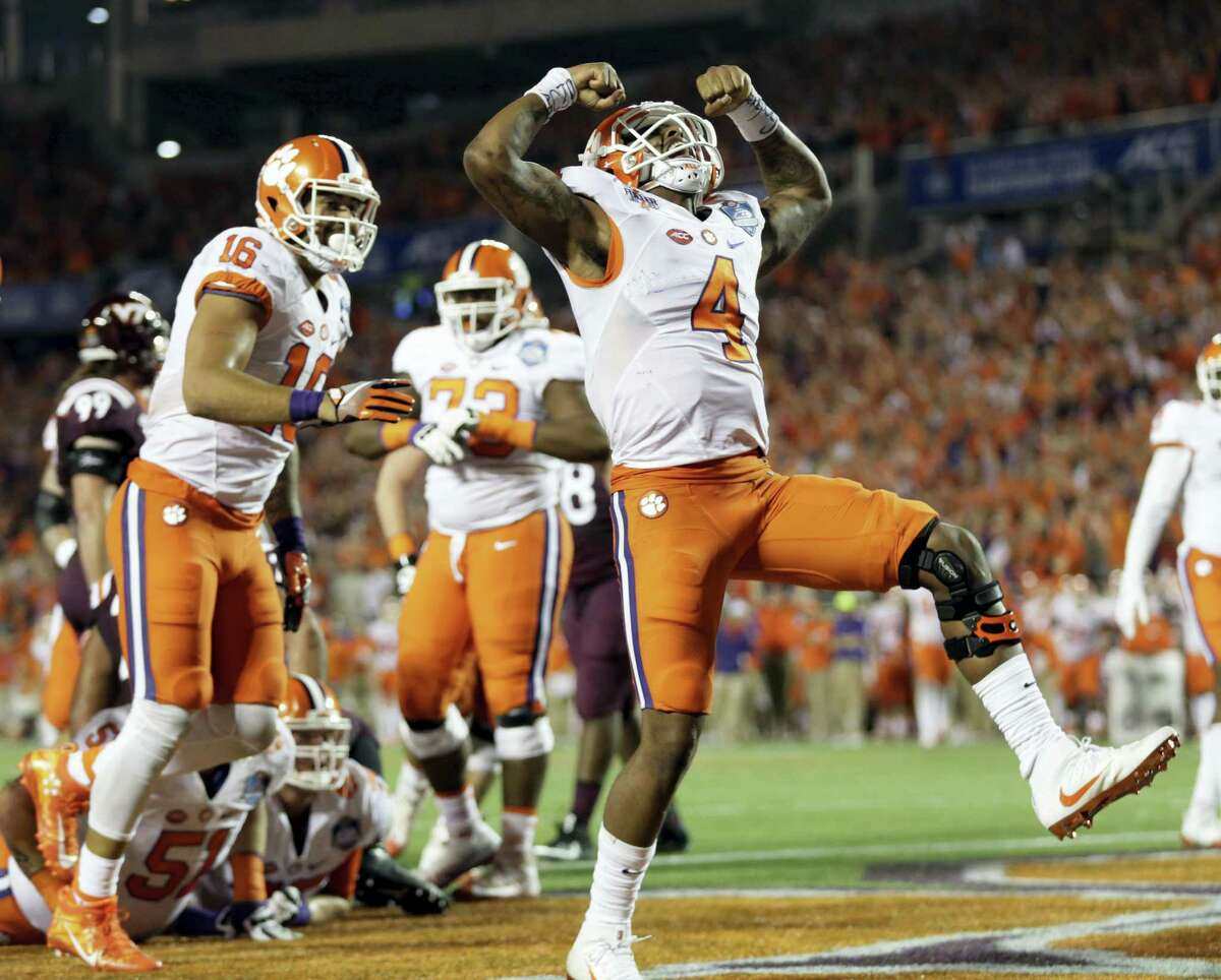 Clemson quarterback Deshaun Watson (4) celebrates his touchdown during the second half of the Atlantic Coast Conference championship game against Virginia Tech.