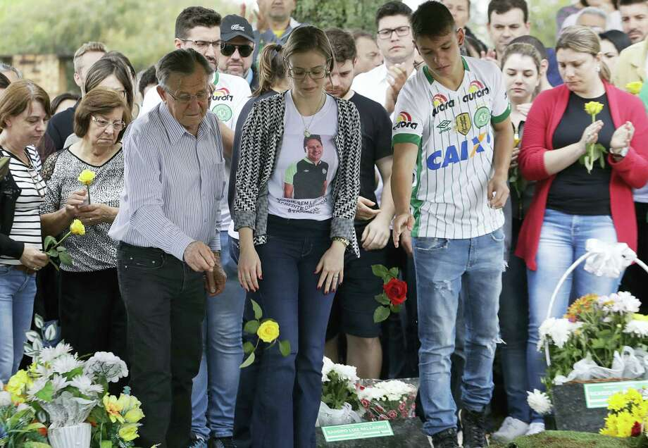 Relatives attend the burial of Chapecoense soccer team's late president Sandro Pallaoro, who died in a plane crash in Colombia, in Chapeco, Brazil on Sunday, Dec. 4, 2016. The accident Monday in the Colombian Andes claimed most of the team's players and staff as it headed to the finals of one of Latin America's most important club tournaments. Photo: AP Photo/Andre Penner  / Copyright 2016 The Associated Press. All rights reserved.