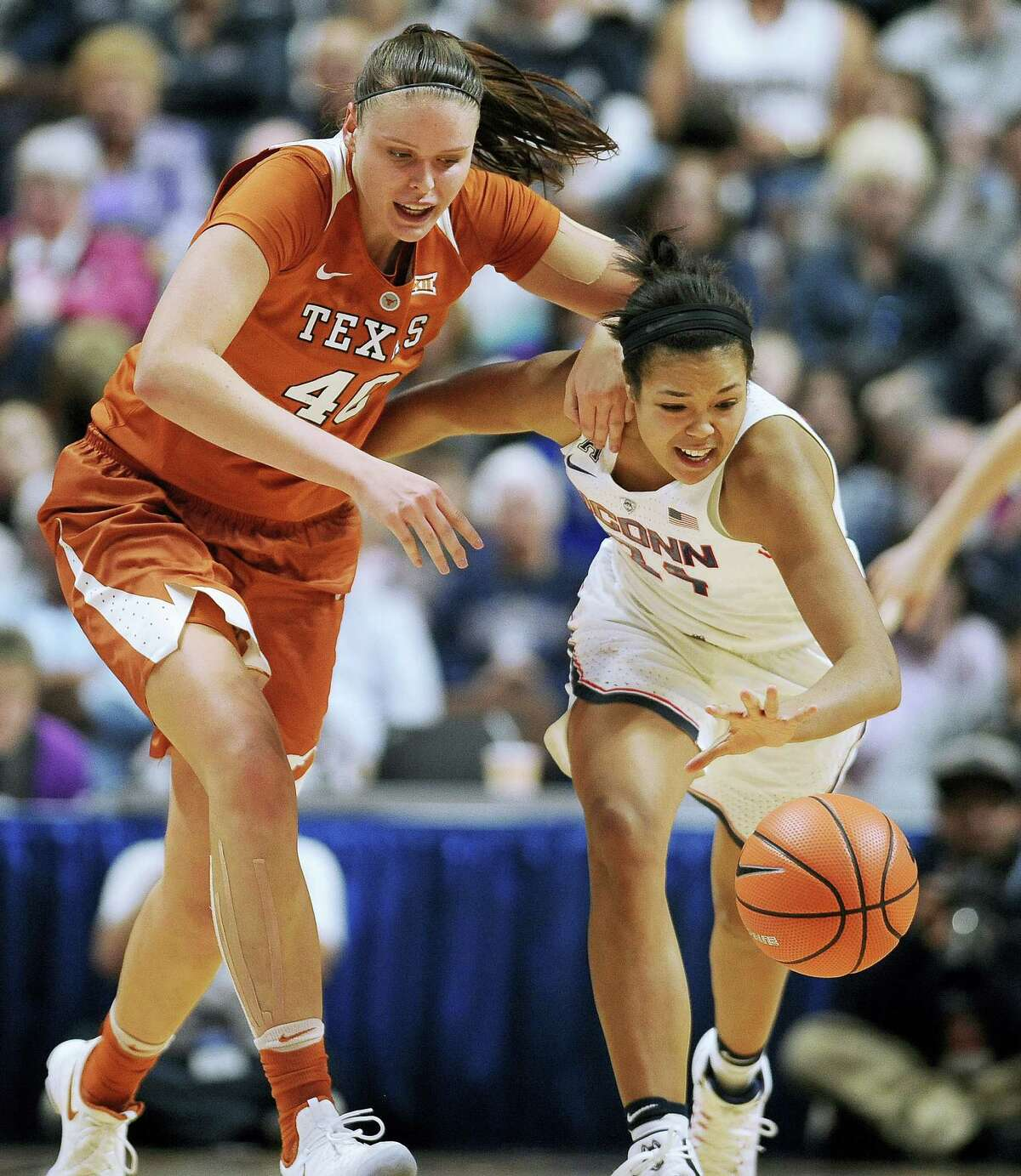 UConn's Napheesa Collier, right, steals the ball from Texas' Kelsey Lang in the second half.