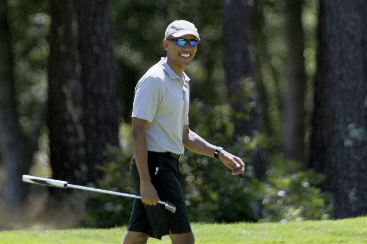 President Barack Obama smiles after putting on the first green during a round of golf at Farm Neck Golf Course in Oak Bluffs, Mass., on Martha's Vineyard on Sunday.