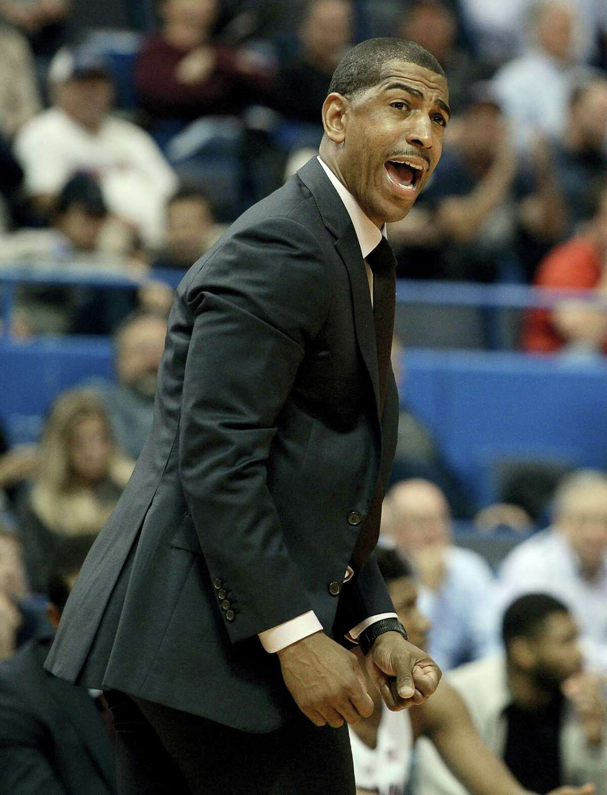 Connecticut head coach Kevin Ollie reacts in the first half of an NCAA college basketball game against Boston University, Wednesday, Nov. 30, 2016, in Hartford, Conn. (AP Photo/Jessica Hill)