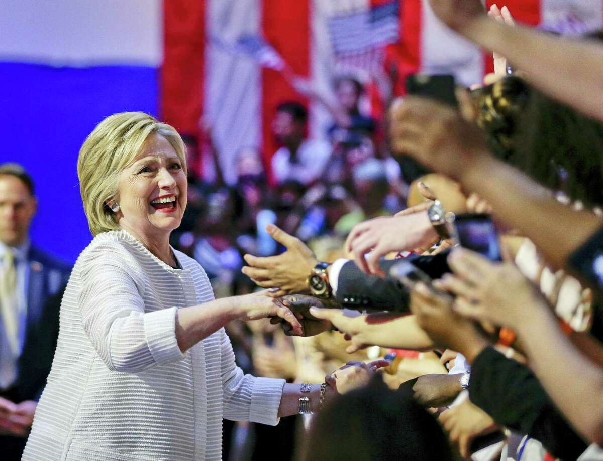 Democratic presidential candidate Hillary Clinton greets supporters as she arrives to speak during a presidential primary election night rally, Tuesday, June 7, 2016, in New York.