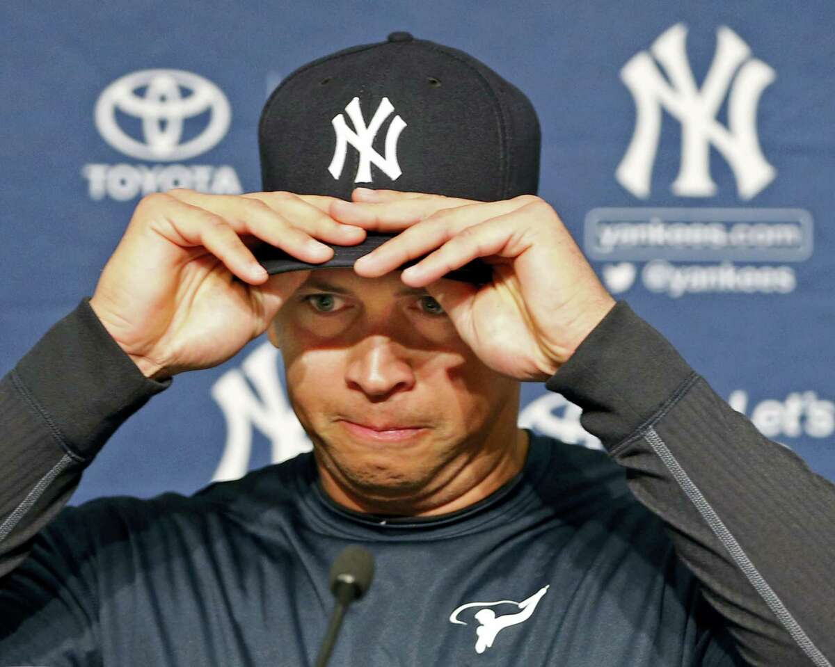 New York Yankees designated hitter Alex Rodriguez struggles putting on his cap before announcing that Friday will be his last game as a player during a press conference at Yankee Stadium in New York, Sunday. Rodriguez will continue on in a role as a special advisor to the team and an instructor through.