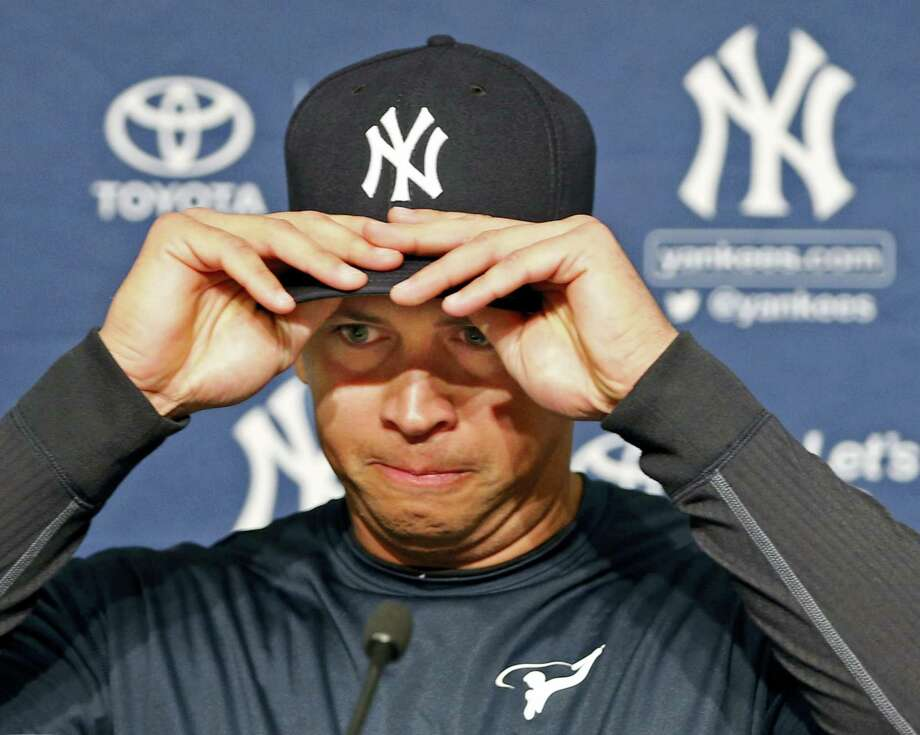 New York Yankees designated hitter Alex Rodriguez struggles putting on his cap before announcing that Friday will be his last game as a player during a press conference at Yankee Stadium in New York, Sunday. Rodriguez will continue on in a role as a special advisor to the team and an instructor through. Photo: Kathy Willens — The Associated Press  / Copyright 2016 The Associated Press. All rights reserved. This material may not be published, broadcast, rewritten or redistribu