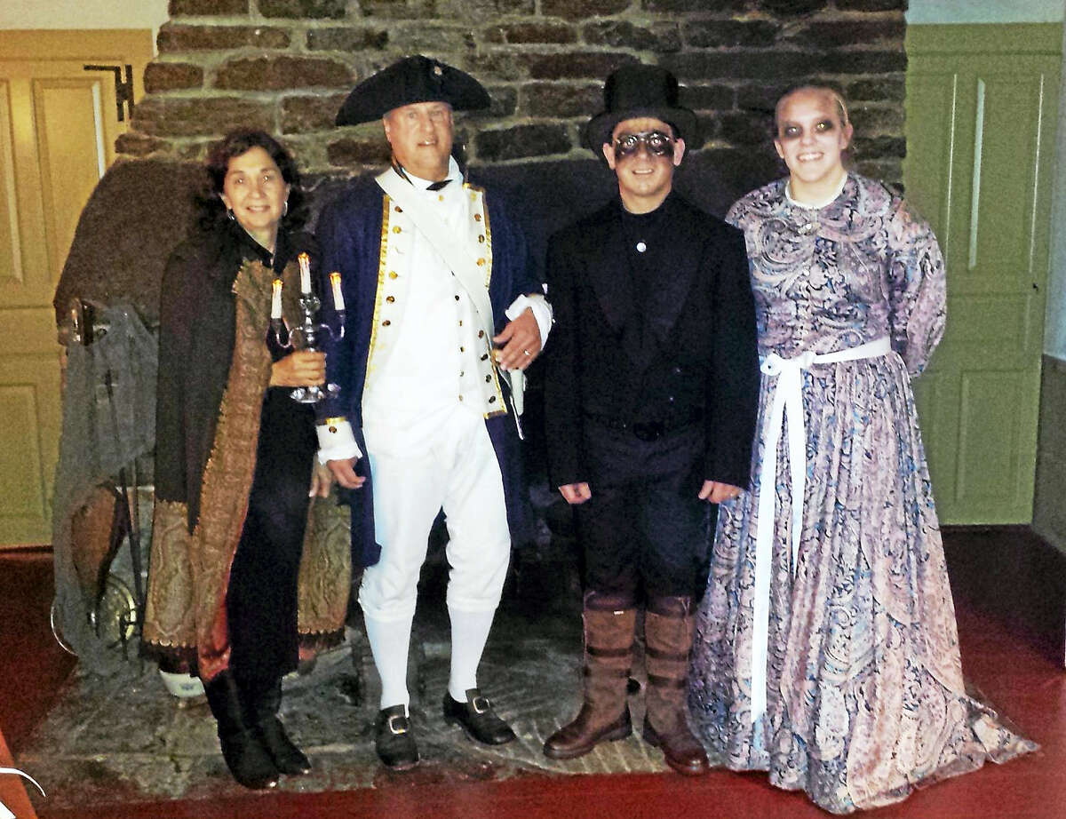 Performers dressed in period costumes prepare for the annual ghost walk tours in Clinton.