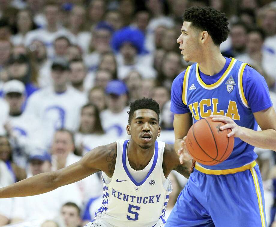 UCLA's Lonzo Ball, right, looks for a teammate while guarded by Kentucky's Malik Monk on Saturday. Photo: The Associated Press   / FR6426 AP