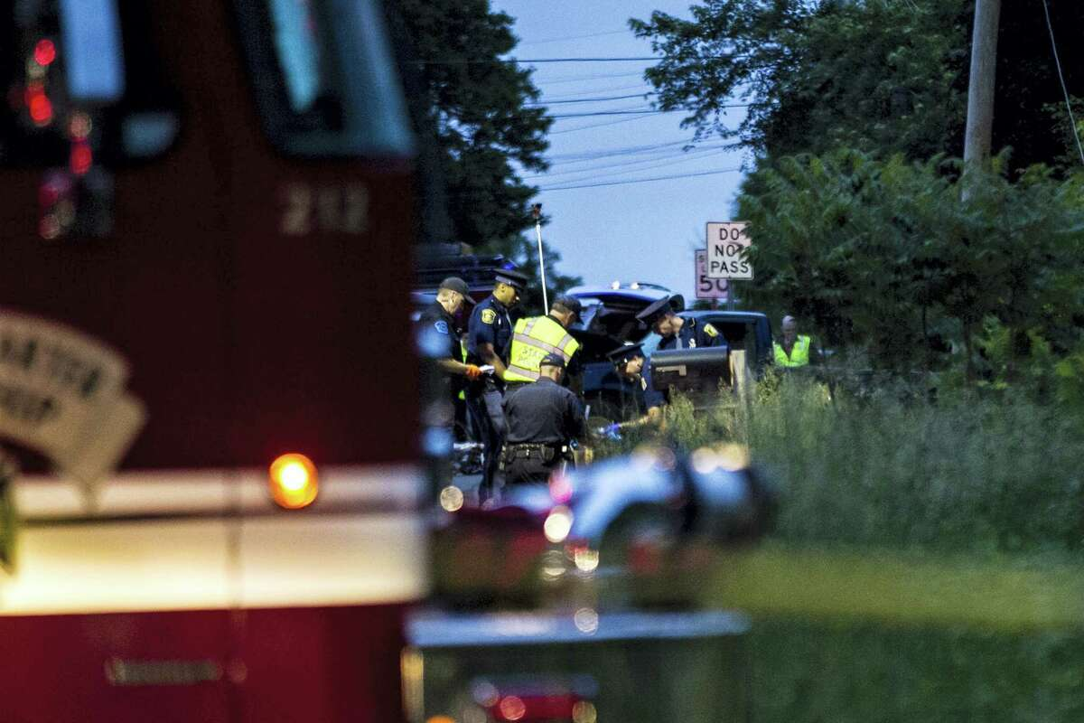 Police and rescue workers were rushing to the 5500 block of North Westnedge Avenue to help cyclists who were apparently struck and badly injured by a truck in a hit-and-run collision on Tuesday, June 7, 2016, in Kalamazoo, Mich.