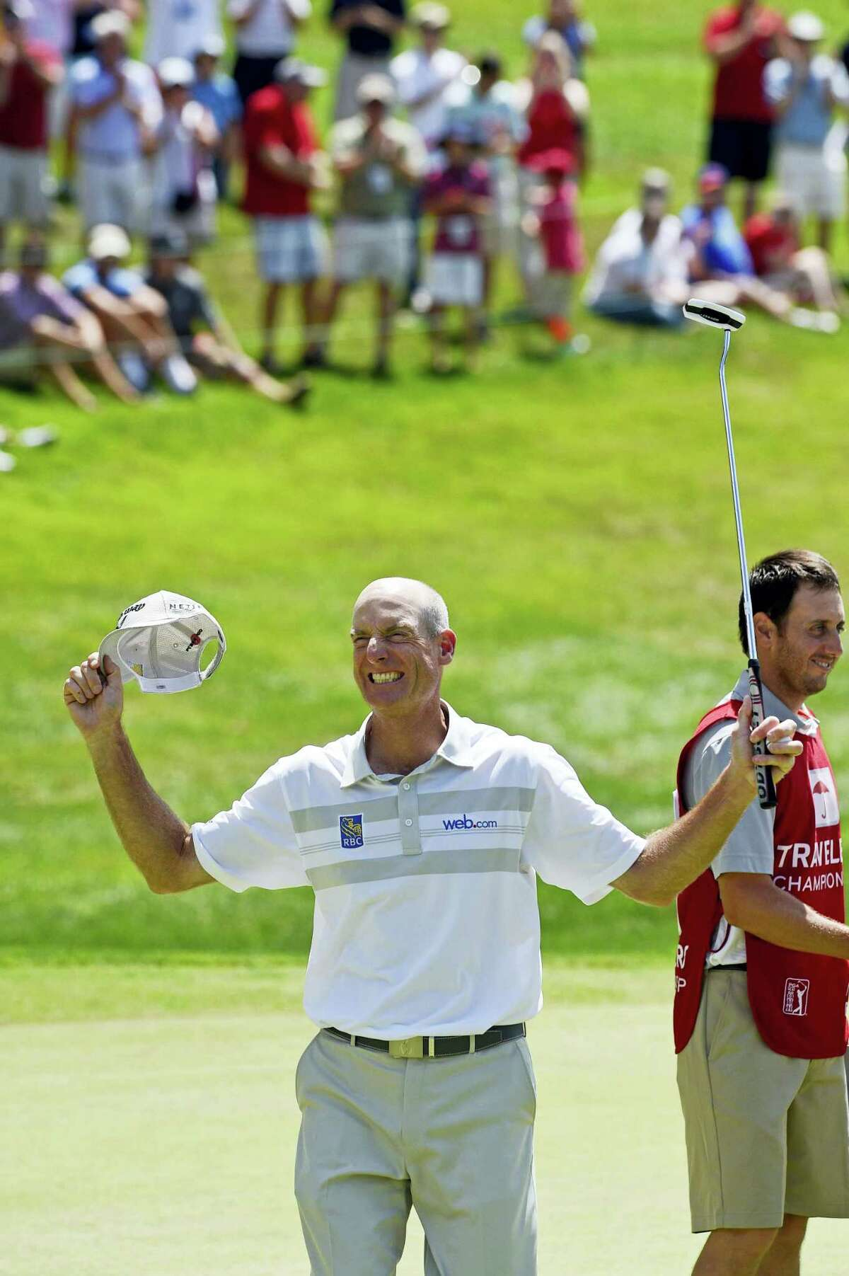 Jim Furyk celebrates after shooting a PGA-record 58 during the final round of the Travelers in Cromwell on Sunday.