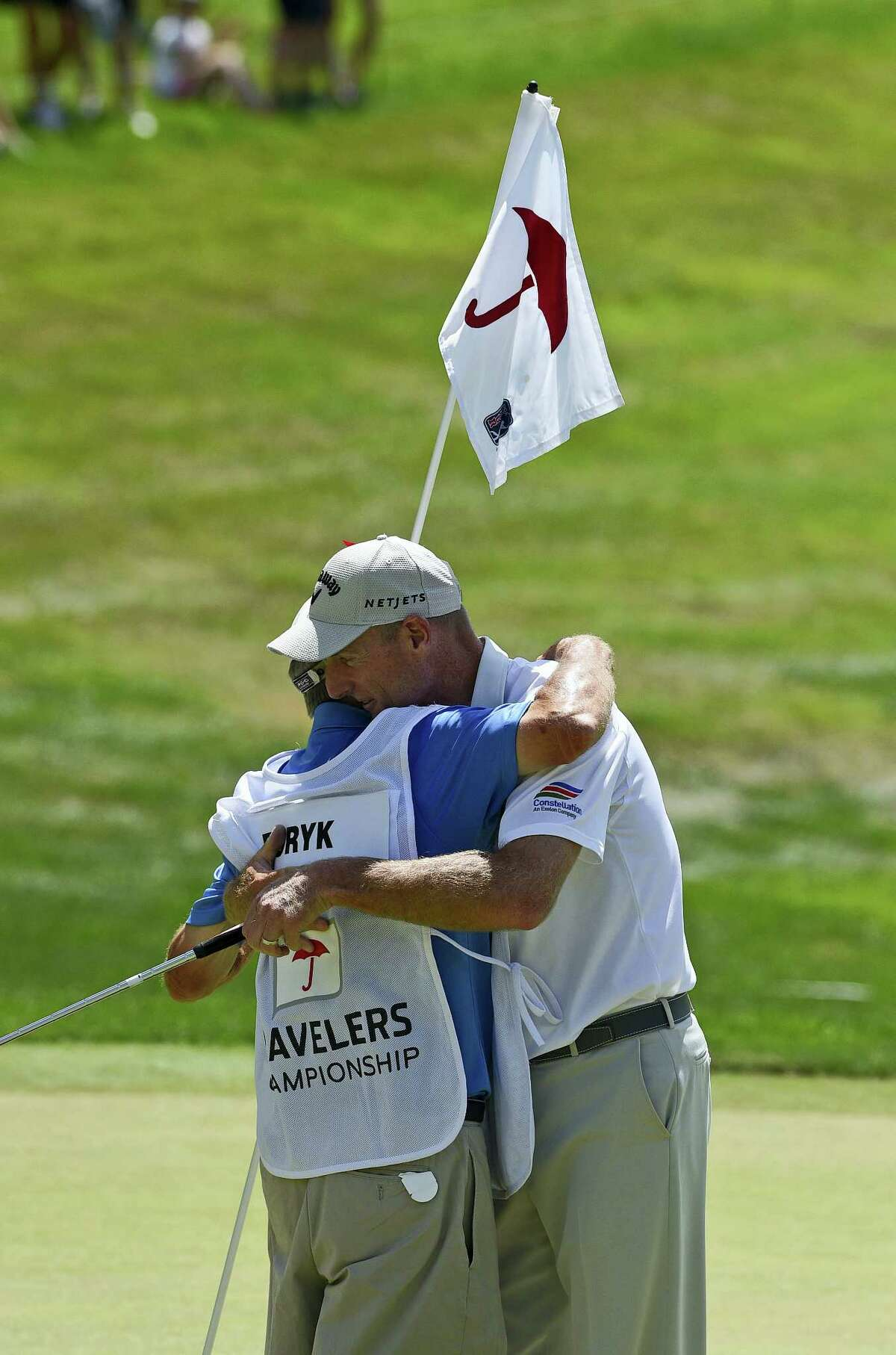 Jim Furyk celebrates with his caddy Mike 'Fluff' Cowan after shooting a PGA record 58 during the final round of the Travelers on Sunday.
