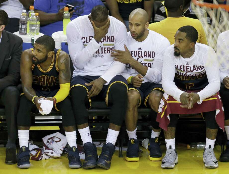 From left, Cavaliers Kyrie Irving LeBron James, Dahntay Jones and J.R. Smith sit on the bench during the second half of Game 2 on Sunday. Photo: Ben Margot — The Associated Press  / AP