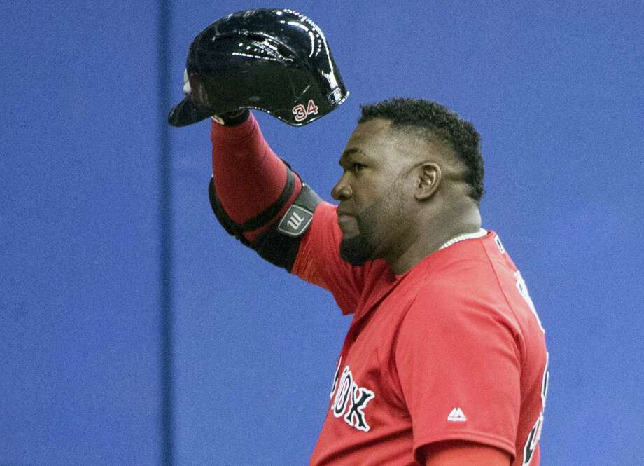 Boston Red Sox designated hitter David Ortiz salutes the crowd as he is introduced for his first at-bat against the Toronto Blue Jays, during an exhibition baseball game Friday, April 1, 2016, in Montreal. Photo: Paul Chiasson/The Canadian Press Via AP  / CP