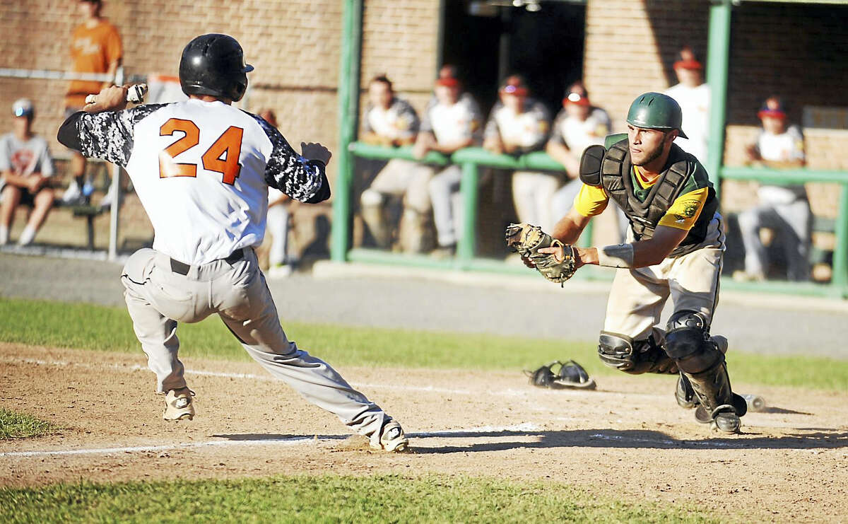 RCP catcher Trevor Whalen gets ready to tag out Cumberland's Jason Doris during Sunday's Northeast Regional championship game at Bristol's Muzzy Field.