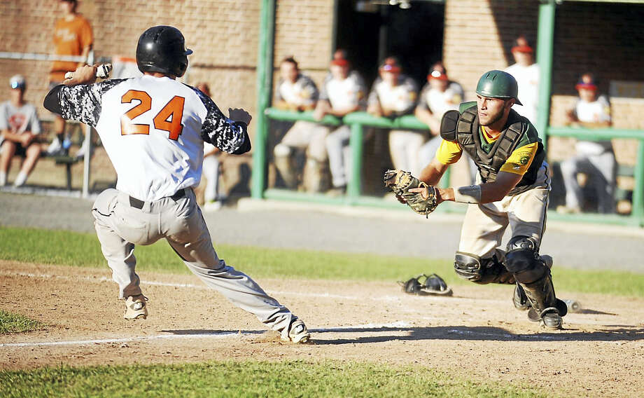 RCP catcher Trevor Whalen gets ready to tag out Cumberland's Jason Doris during Sunday's Northeast Regional championship game at Bristol's Muzzy Field. Photo: Jimmy Zanor - The Middletown Press