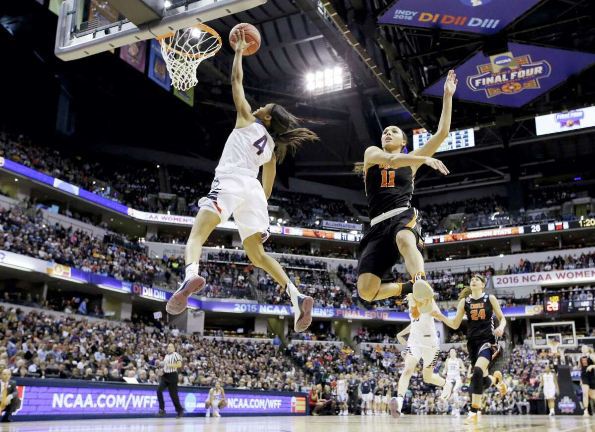 Connecticut's Moriah Jefferson (4) shoots against Oregon State's Gabriella Hanson (11) during the first half of a national semifinal game at the women's Final Four in the NCAA college basketball tournament Sunday, April 3, 2016, in Indianapolis. (AP Photo/Michael Conroy)