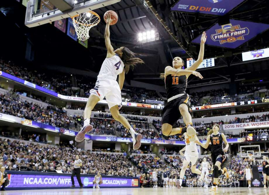 Connecticut's Moriah Jefferson (4) shoots against Oregon State's Gabriella Hanson (11) during the first half of a national semifinal game at the women's Final Four in the NCAA college basketball tournament Sunday, April 3, 2016, in Indianapolis. (AP Photo/Michael Conroy) Photo: AP / AP